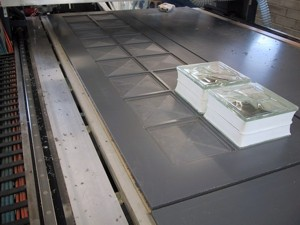 An 18 block mould on the machine (i.e. holds 2 rows of 9 glass blocks)