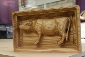 Small model cow carved into Ash